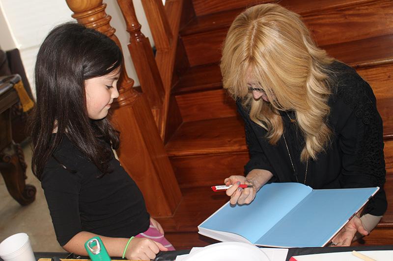 Noa Coane getting her book signed